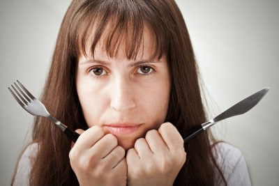 Woman with knife and fork