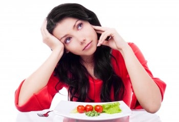 Woman thinking about healthy food