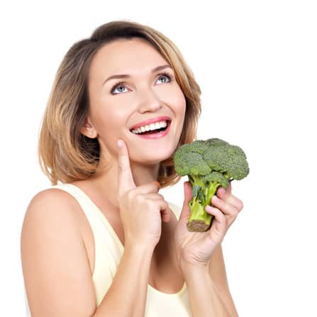 Woman holding broccoli