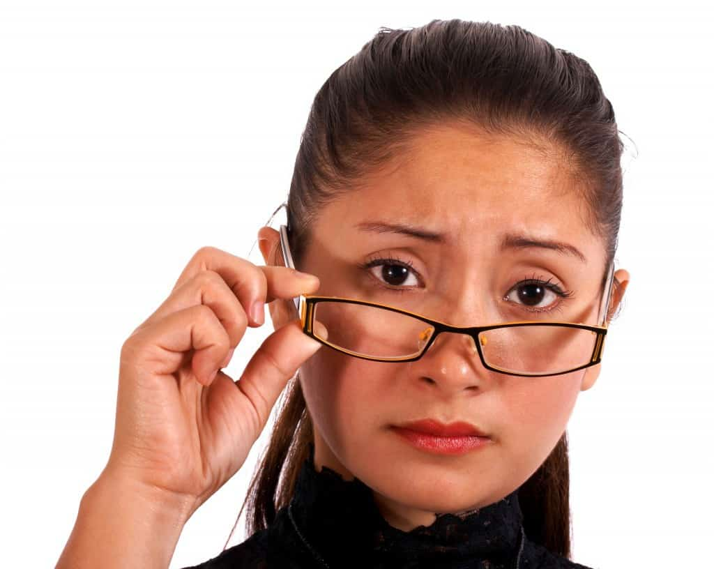 Woman wearing glasses, worried