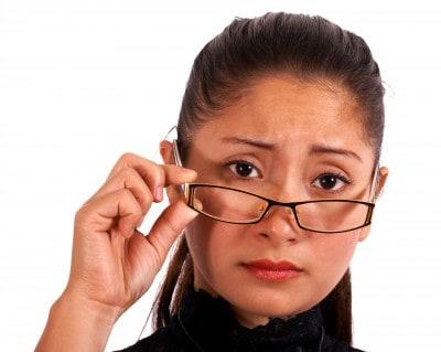 Woman wearing glasses, worried