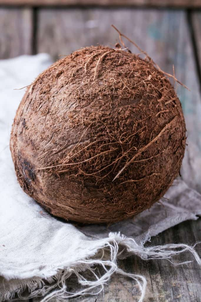 Whole coconut on a table