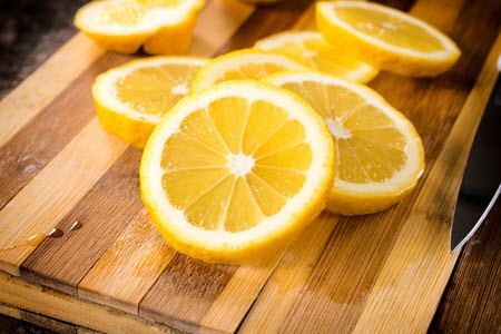 Sliced lemons on a cutting board