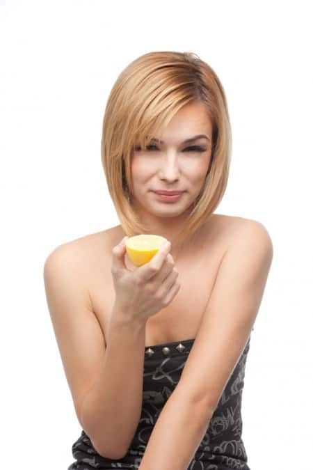 Woman with half a lemon