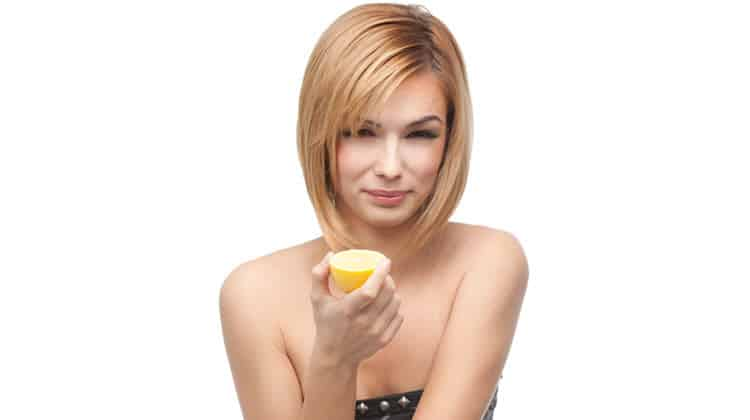 Woman with lemon, lemon water thumbnail