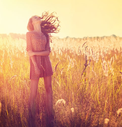 Girl in the sun in a field