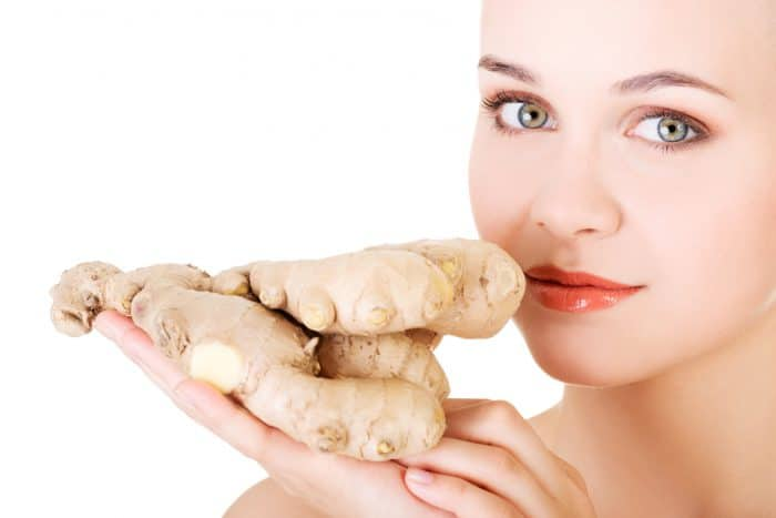 Beautiful woman with fresh ginger