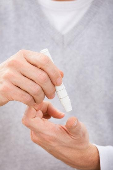 Man testing blood sugar level