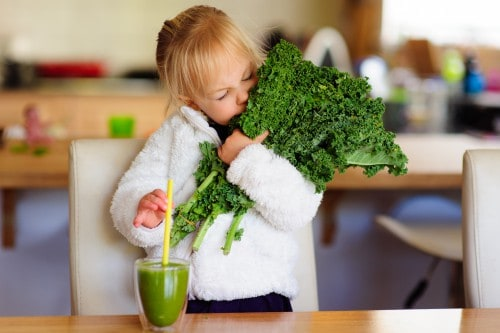 Girl holding kale