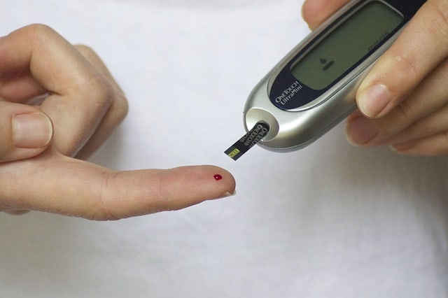 Person with diabetes measuring blood sugar levels