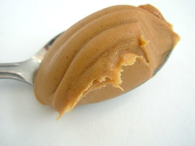Dessert spoon of peanut butter