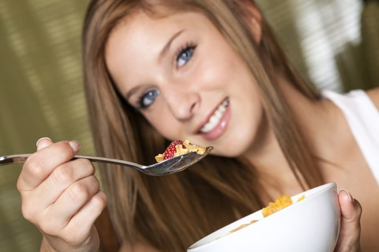 Teenage girl having breakfast