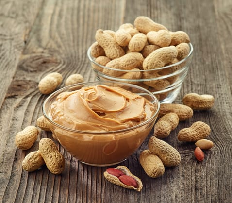 Bowls of peanut butter and peanuts
