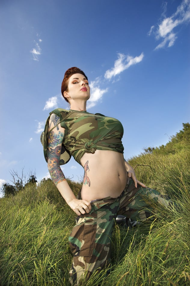 Woman in military  fatigues.