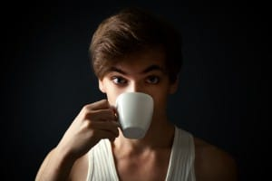 Surprised man drinking coffee