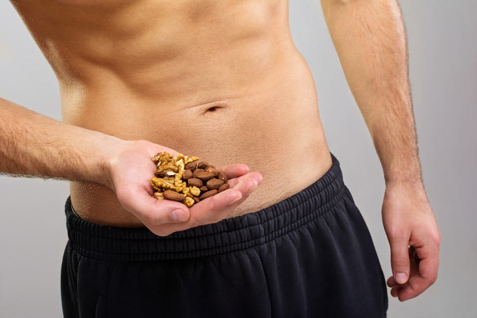 Man with a handful of nuts