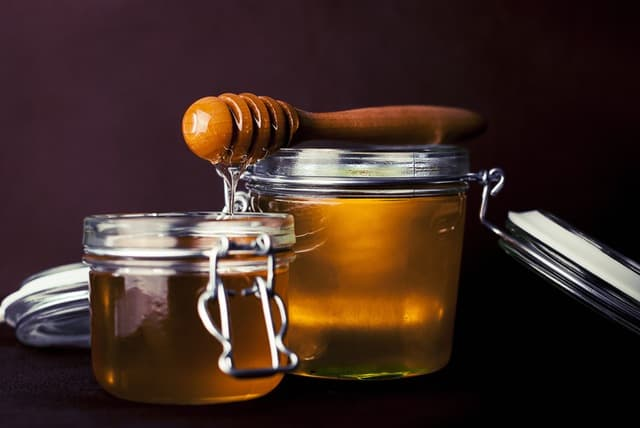 Clear honey in a jar