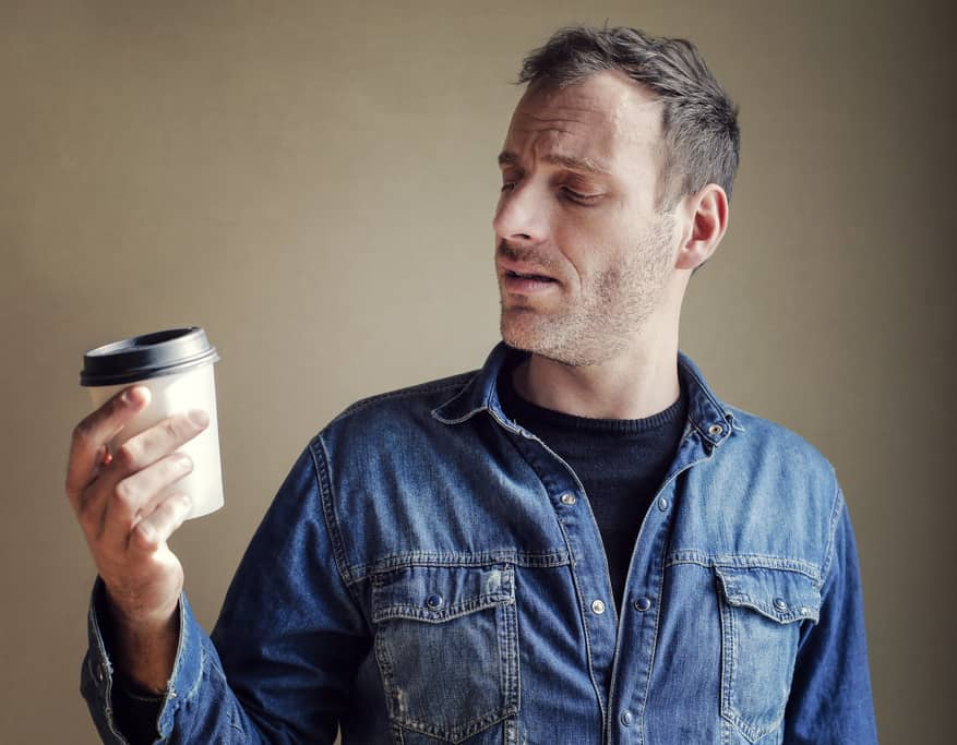Man staring at coffee