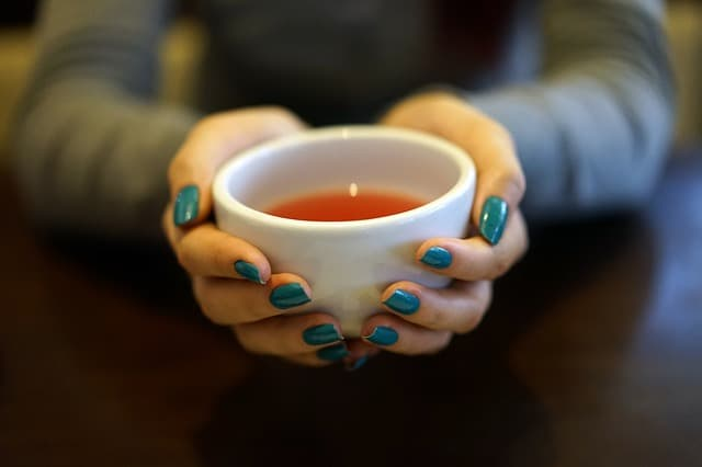 Hands holding tea