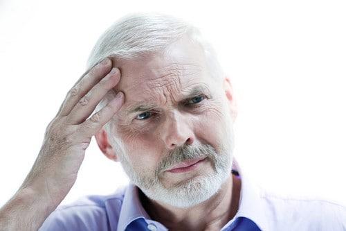 Senior man portrait head ache