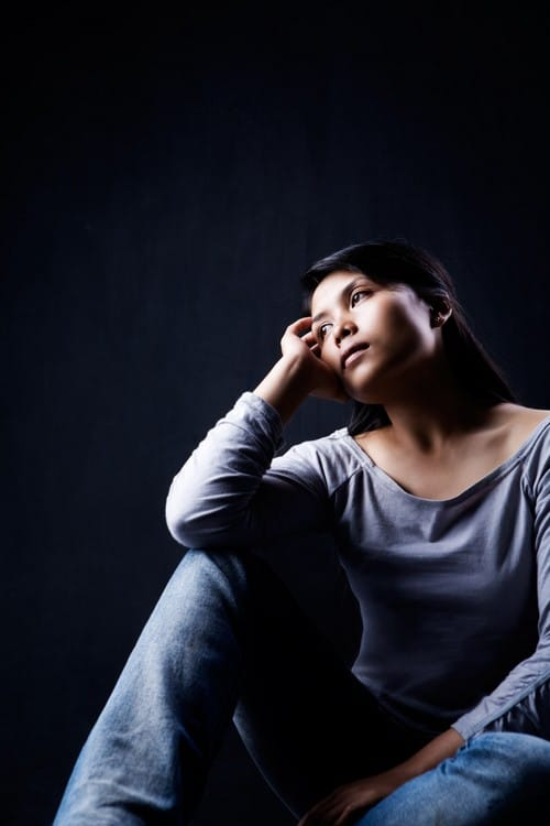 Depressed woman in the dark