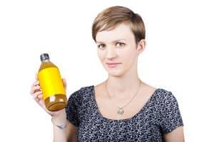 Woman holding apple cider vinegar