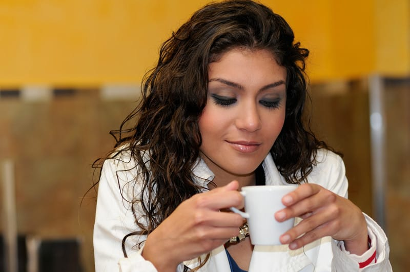 Woman with a cup of coffee or tea