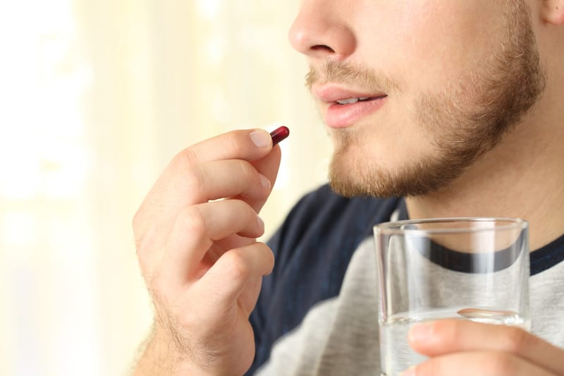 Man taking a supplement