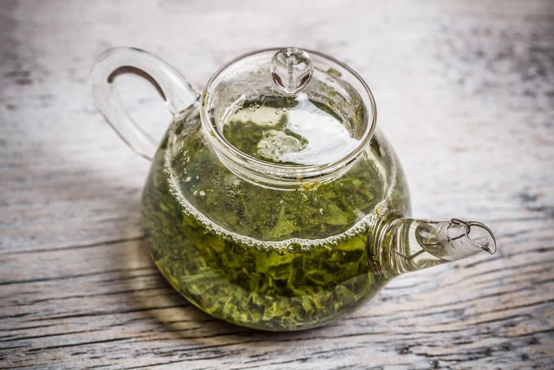 Green tea in a teapot