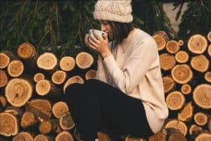 A girl having a hot drink