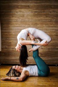 An advanced partner yoga pose