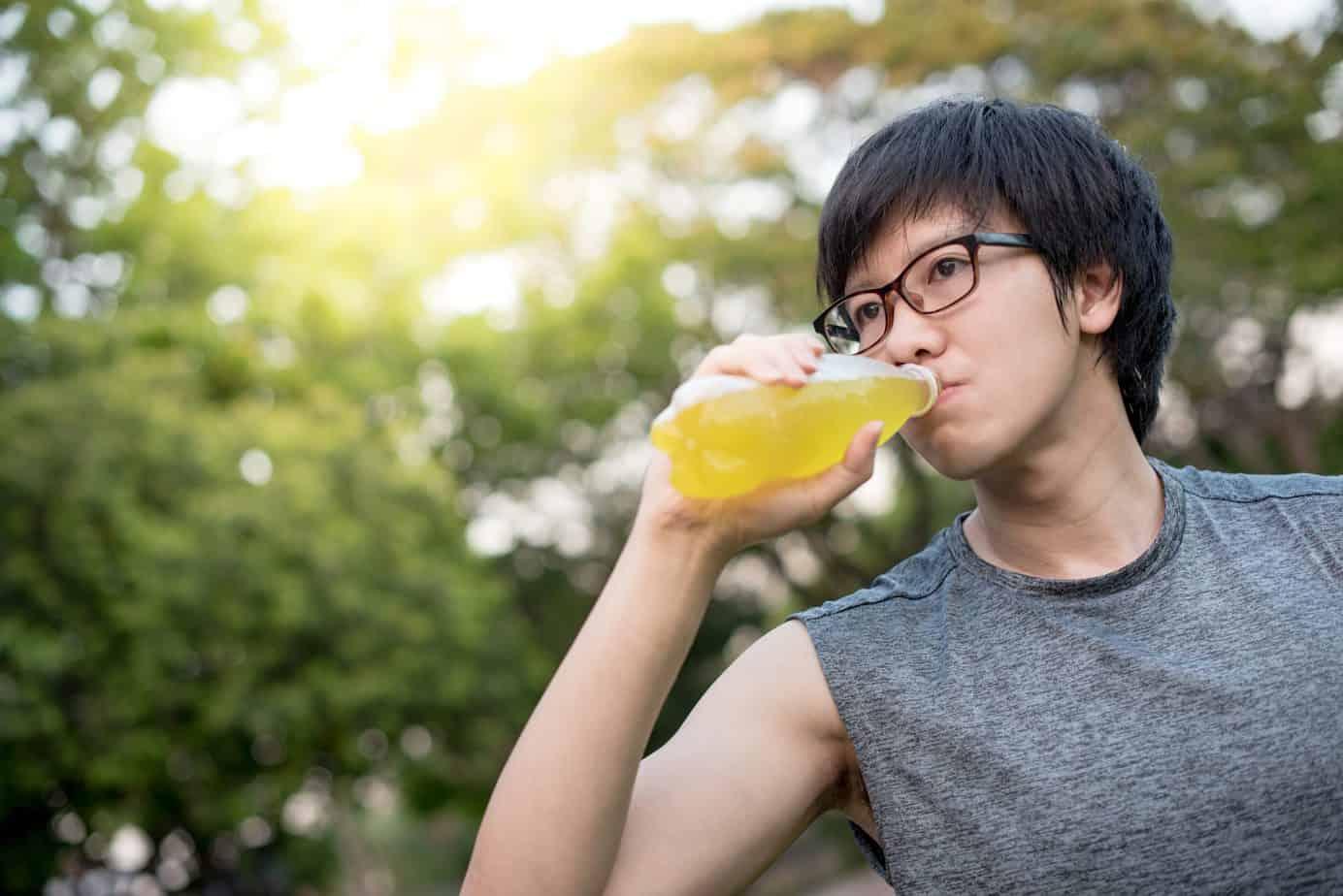 runner drinking energy drink